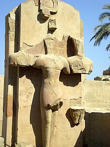 This was an example of how the Christians defaced the pagan Egyptian sculptures in the 300s AD. They cut out everything except for the shape of a cross, to better suit their imagery.