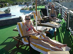 Kelly and Mom Klocke sunbathing atop our cruise ship! Kelly's hard at work on her daily diary.