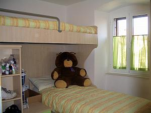 Our second bedroom - with bunk beds! And a giant stuffed bear.
