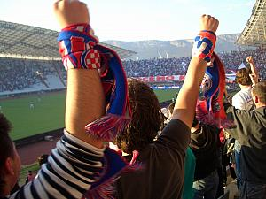 Cheering for Hajduk - many fans have these scarfs.
