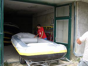 New rafting experience -- going to the garage to pick up our raft and pump it full of air, before heading to the river.