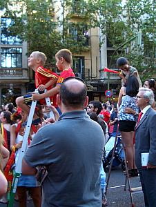 We were amused to see many step-ladders out lining the streets so that short people and kids can see over the crowd.