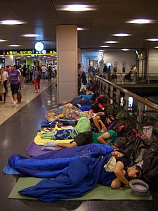At Madrid Barajas airport, at about 4:45am for or 6:30am flight. Hundreds of people camping out sleeping on the floor! The subway from Madrid to the airport shuts down between midnight and 6am, so many backpackers catch the midnight subway and camp out at the airport overnight to avoid another night's lodging fees and the expensive middle-of-the-night taxi ride. (We went middle-of-the-road and booked a shared-taxi.)