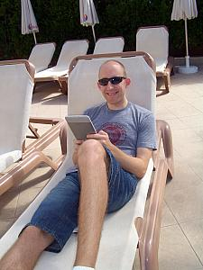 Jay reading his Kindle at the pool
