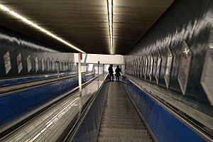 Riding the escalator down into the subway station