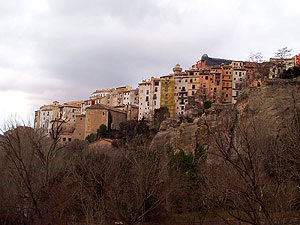 "Cuenca's old town is perched up on a cliff. The houses built right up out of the cliff side are called hanging houses - ""casas colgadas"""