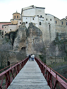 Crossing a high bridge into Cuenca's old town
