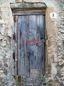 a run down door in Cuenca that serves little purpose since there is a big hole beneath the door. I guess it does provide some privacy.