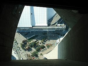 Looking down to the ground through the see-through tower.