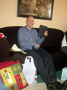 Jay opening a gift -- a Michael Connelly book (just finished reading it last night, 4/13!)