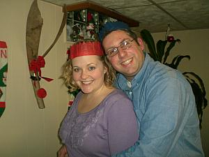 Chad and Jenny posing with their Christmas crowns