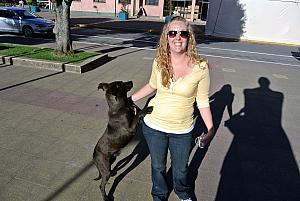 Puerto Montt, chile - Kyleen greeting a dog - several of the towns we visited had many wild dogs
