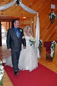 Here come the bride, with her father