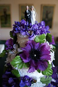 A pretty wedding cake made out of towels; the cake topper was used on Kelly's grandsparents' wedding cake.