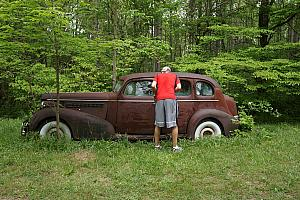 The cabin sat on 300 acres of land -- this old, abandoned buick was sitting in a field on the property