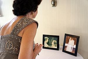 Mom Klocke checking out the parents' wedding photographs