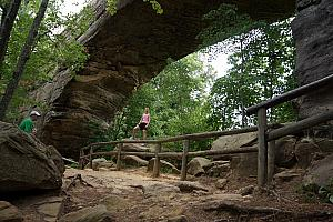 Kelly providing a frame of reference for the impressive Natural Bridge