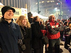Kevin, Kyleen, Mom and Dad Klocke at Fountain Square watching Santa repel down the side of a building