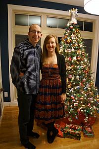 Jay and Kelly in front of the tree.