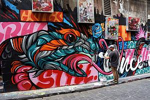 The most famous street for graffiti is this one - Hosier Lane. Here's an artist in action.