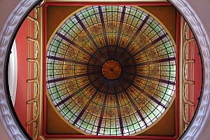 Walking through a mall, a pretty domed ceiling with stained glass windows.