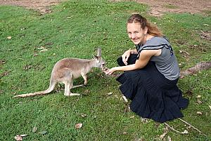 Kelly feeding a Kangaroo kid.