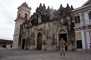 Standing in front of another church - this half of the facade has not been restored from a past fire, but the other half had been.