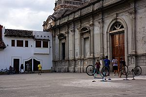 Here's the other half of the church facade, and some local boys playing soccer on the plaza in front of the church, using two upside-down bikes to serve as each goal.