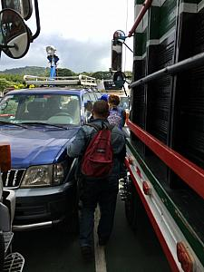 Squeezing through the trucks and cars as we exit the ferry.