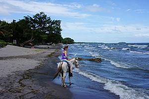 Riding along the beach -- it was fun to canter along the beach.
