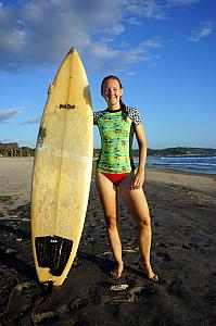 Kelly modeling her board and rash-guard shirt.