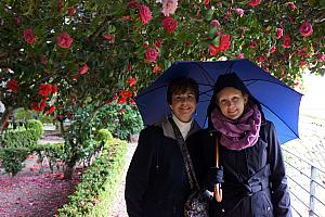 Mom and Kelly in front of a camellia tree