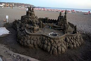 Impressive sand castle along the beach.