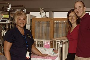 Photo with one of our amazing nurses in the NICU (Captured by The Tiny Footprints Project. Thank you!)