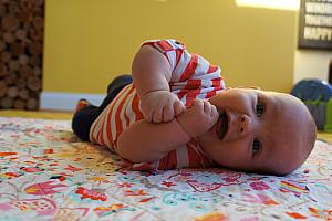 Enjoying tummy time, and learning how to roll over from belly to back!