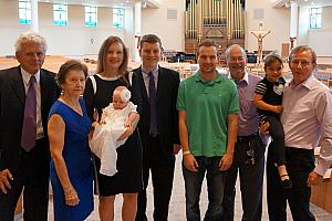 The baptismal dress that Capri is wearing has been worn by every member of the Klocke family for 70+ years -- here's a photo of some of the wearers.,
