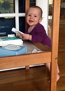 Happily playing with her changing table