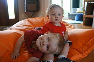 Coop and Benny playing with the beanbag chair