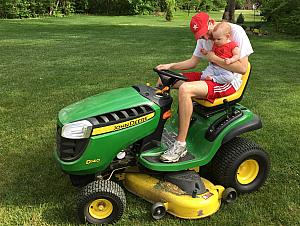 Capri's first lawnmower ride. She wasn't very sure about it -- too noisy.