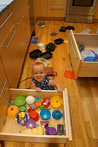 Capri having fun with all the kitchen drawers. Unfortunately, not just her toy drawer.