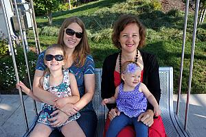 Moms and daughters on the family swing at Smale Park