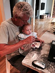 Capri eating some yogurt with Grandpa