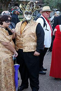 In front of the church was a group of people dressed for a masquerade ball. Fun.
