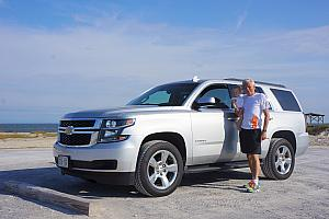 Grandpa posing with his beast of a rental car - a 2015 Chevy Tahoe.