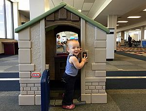 Capri enjoying the playhouse in Mobile Alabama airport