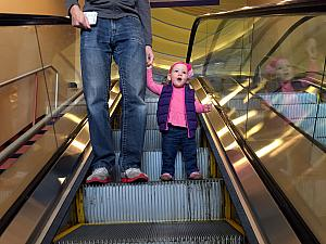 Capri excited for the escalator ride.