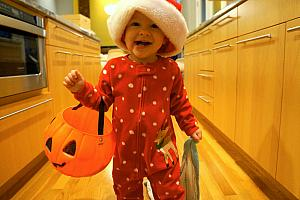 Running around the house wearing the Christmas hat and carrying her blankie and the pumpkin. That makes perfect sense!