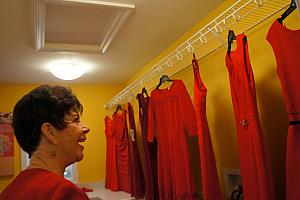 Grammy Klocke looking at her store of red dresses -- she got to pick two to keep.