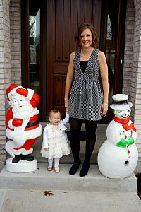 Capri and Mom visiting our friends Santa and Frosty on the front porch.