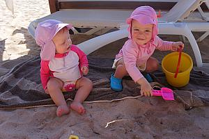 And Capri and Kenley are having fun playing in the sand